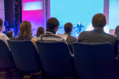 People sitting rear at the business conference
