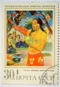 Moscow, Russia - October 3, 2015: A stamp printed in the USSR shows a painting Woman with Fruit by Gauguin from the series Foreign Paintings in Hermitage, Leningrad, circa 1970