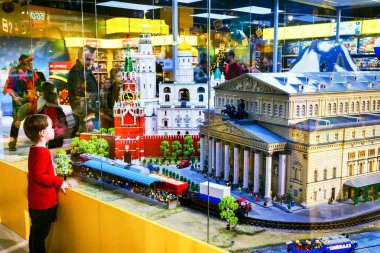 MOSCOW, RUSSIA - DECEMBER 11, 2015: little boy looking at the Moscow sights as Bolshoy theatre and Red Square made by Lego blocks in Central Children's Store on Lubyanka.