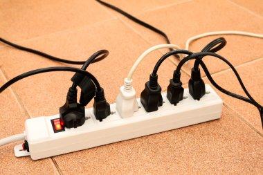 overloaded power boards outlet multiple socket electrical plug