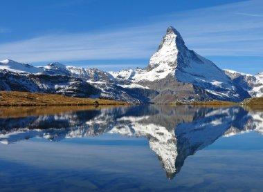 Snow Capped Matterhorn Mirroring In Lake Stellisee