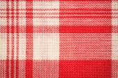 Textile surface. Red and white cloth texture
