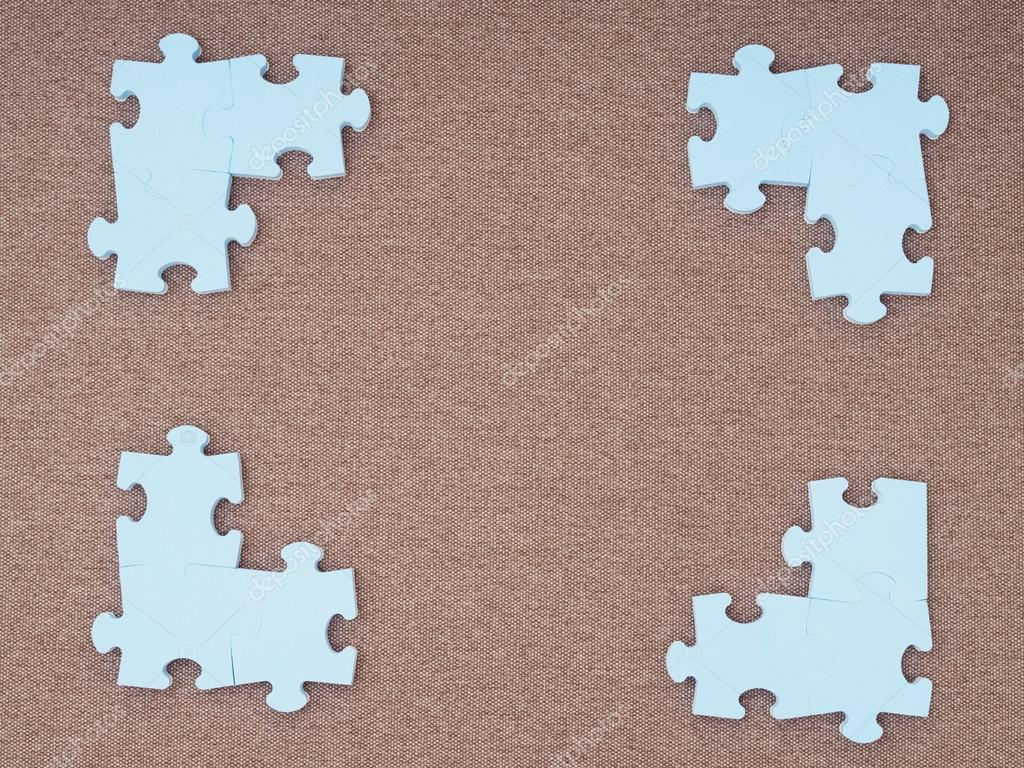 Concept of blue puzzle pieces on brown background