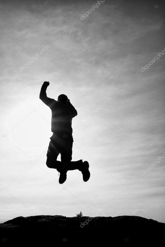 Young Man Falling Down On Sky Background Stock Photo