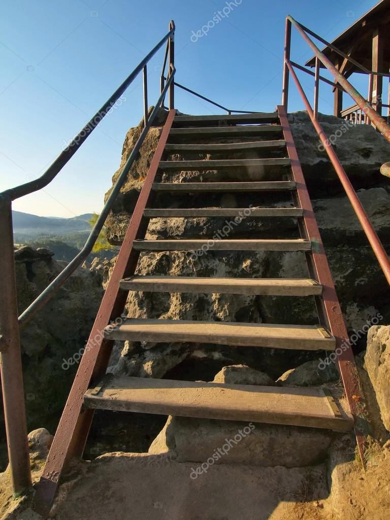 The Irony Wooden Ladder With Bended Steel Handrail In Touristic Path To Viewpoint Worn