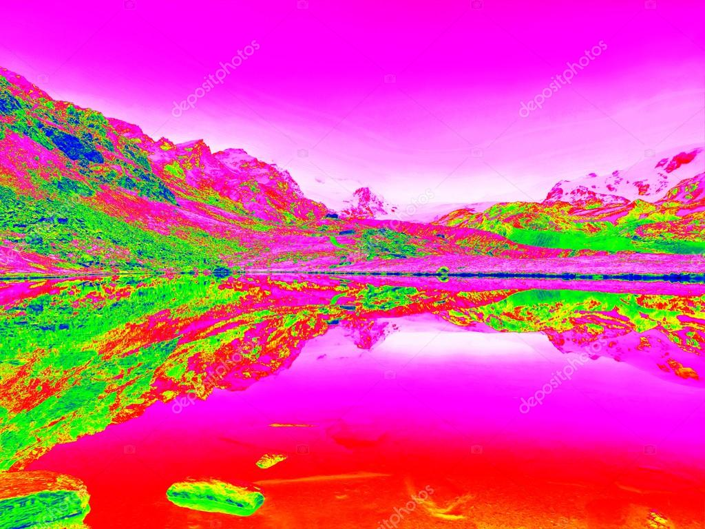 Lake level between sharp mountains in amazing thermography.