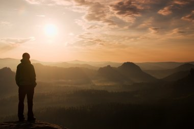 Hiker stand on the sharp corner of sandstone rock in rock empires park and watching ove