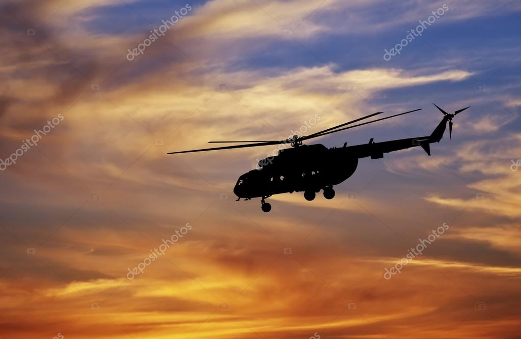 Picture of helicopter at sunset.