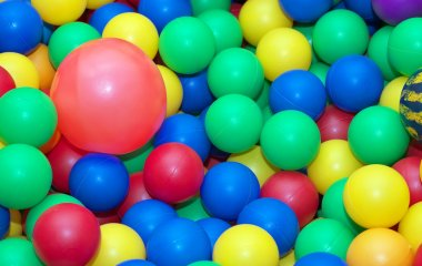 Toy rubber balls background. Balls for children in the children
