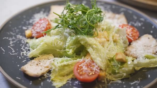 Close-up of caesar salad with chicken fillet and parmesan cheese