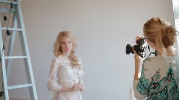 Model pose to photographer in studio
