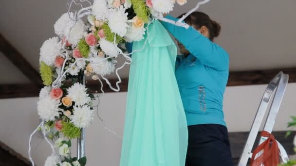 Woman decorate wedding arch with the green fabric stock video woman decorate wedding arch with the green fabric stock video junglespirit Choice Image