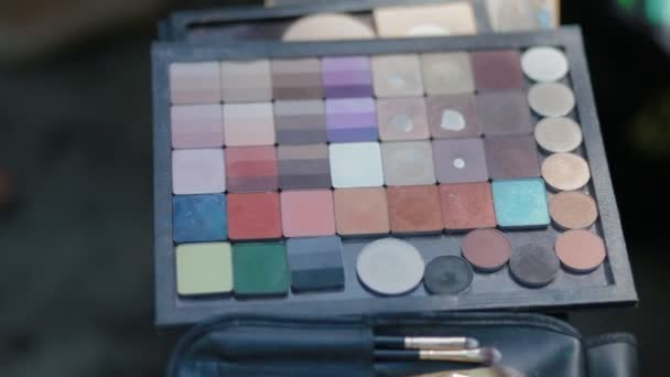 Palette of colorful cosmetics, brushes for make up