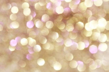 Gold and silver and purple abstract bokeh lights, defocused background
