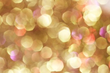 Gold and purple and red abstract bokeh lights, defocused background