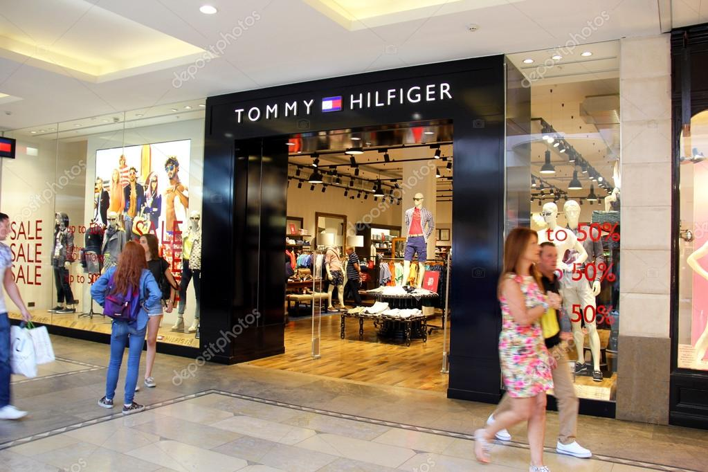 8a512a3d0 London, England. Circa July 2014. Entrance of Tommy Hilfiger Store in Blue  Water shopping Mall in England.