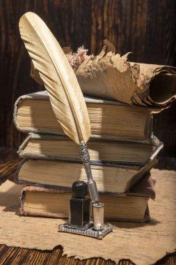 Vintage golden pen and ancient manuscripts