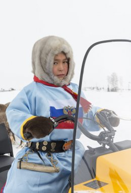 Boy on a snowmobile on a holiday