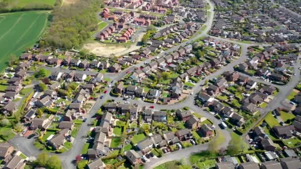 Aerial footage of a typical British residential housing  estate in the Village of Kippax in Leeds West Yorkshire, showing suburban housing estates and road in the village.