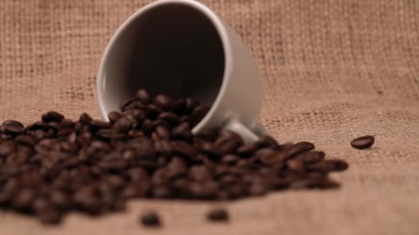 Cup of coffee and coffee beans in the sack