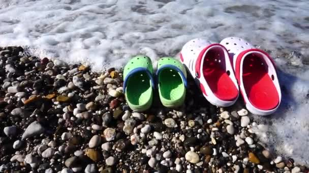 Slippers near the Seaside and Waves