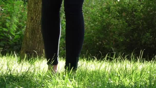 Woman Takes Shoes off on Grass