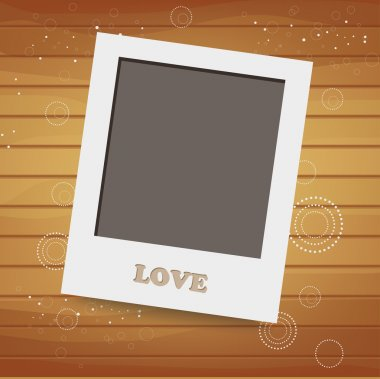 Blank instant photo on background with heart
