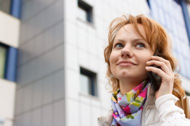 Girl is talking by phone