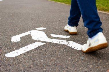 Sign of pedestrian zone on sidewalk