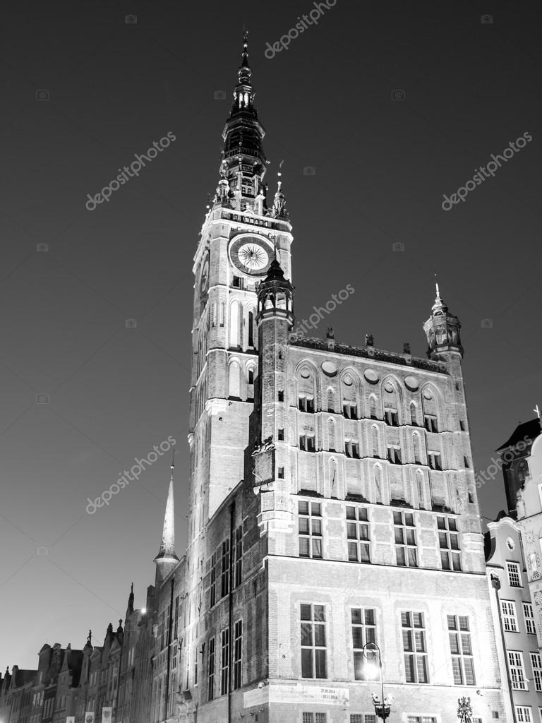 Night shot of beautiful baroque clock tower of gdansk town hall black and white image photo by