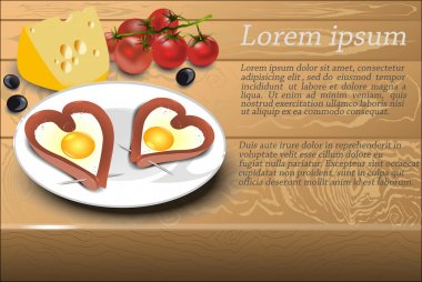 Scrambled eggs with sausage in a heart shape on a white plate, d