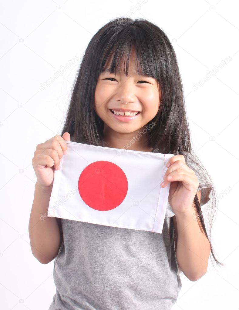 日本の国旗を保持しているかわいい女の子 — ストック写真 © paulaphoto