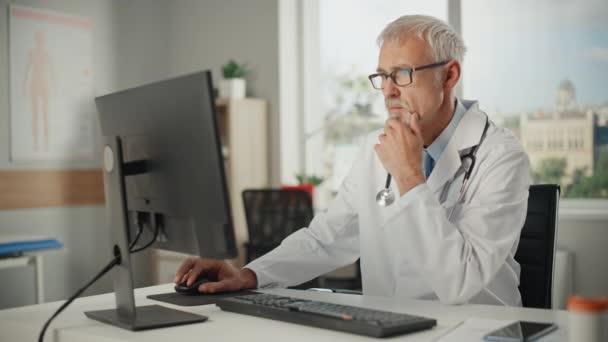 Doctor in Office uses Desktop Computer