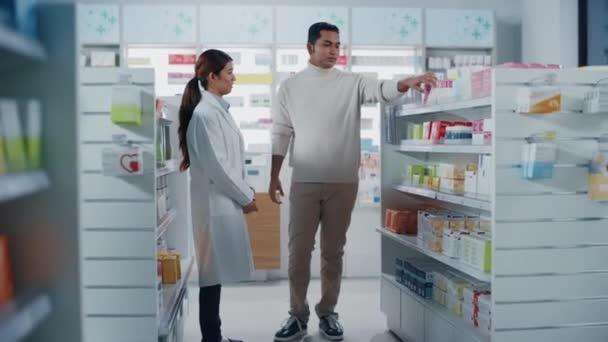 Costumer Talks to Pharmacist in Pharmacy