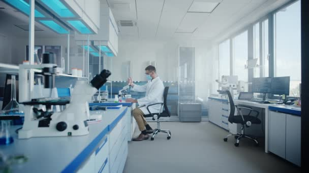In Laboratory Scientists in Face Mask Working