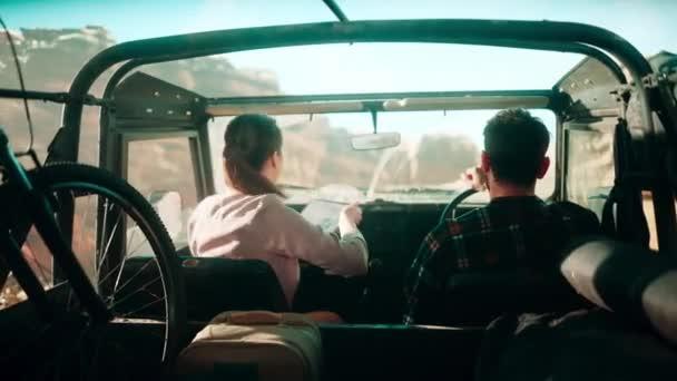 Travelers Riding in Car Desert