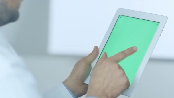 Doctor Using Digital Tablet with Green Screen