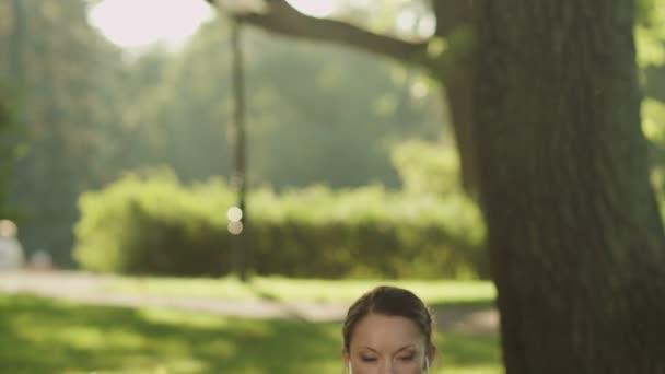 Pretty Girl Meditating in Park. Jib Shot.