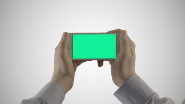Using Mobile Phone With Green Screen on White Background. Great For Mock-up Usage.