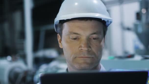 Engineer is Using Tablet in Factory