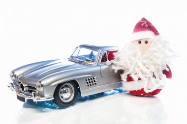 Santa Claus or Father Frost with old retro car