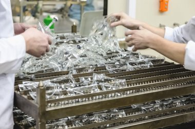 Workers sorts production on pharmaceutical industry manufacture