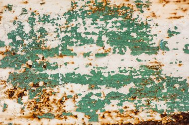 Cracked paint on rusty metal surface
