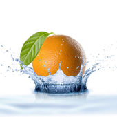 Orange Falling Into Water Splash