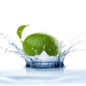 Lime Falling Into Water Splash