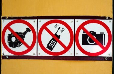 Signs prohibiting pictures, shoot video and use of mobile commun