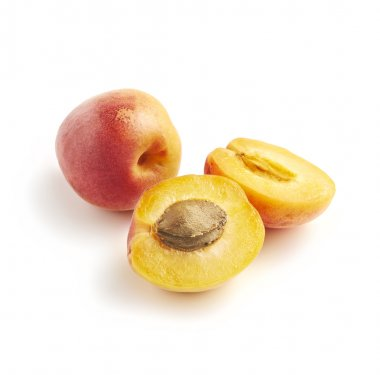 Halved and whole apricots on white