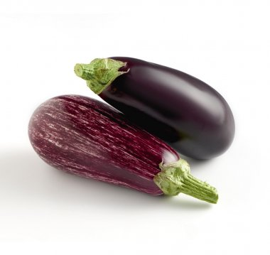 Two whole fresh aubergine varieties