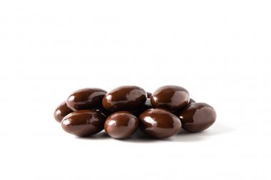 Dark chocolate covered almonds, isolated.