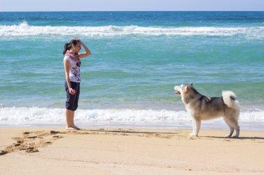 Girl with Eskimo dog